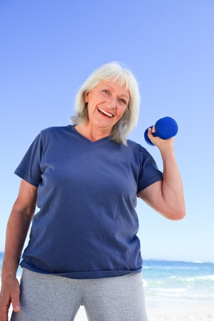 Mature woman doing her exercises Stock Photo - 10197371