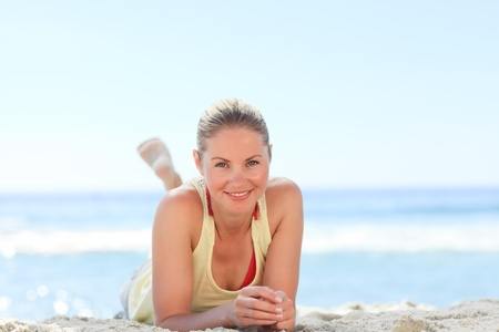 Lovely woman sunbathing at the beach Stock Photo - 10196618