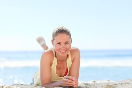 Lovely woman sunbathing at the beach photo