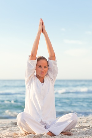 Peaceful woman practicing yoga  photo