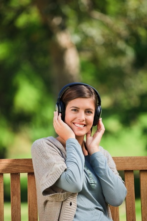 Woman listening to some music photo