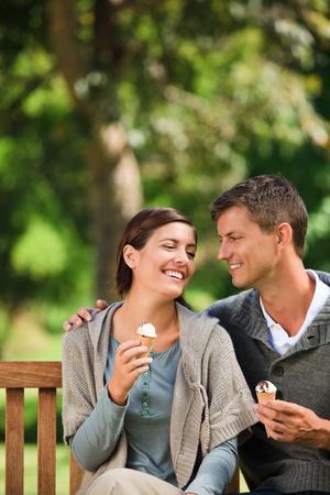 Couple eating an ice cream photo