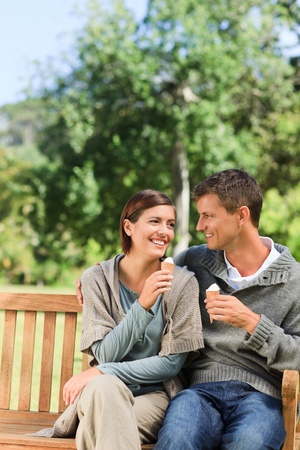 Young couple eating an ice cream photo