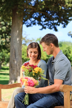 Man offering flowers to his girlfriend photo