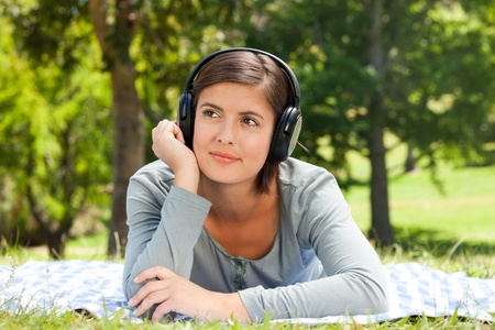 Woman listening to some music in the park photo