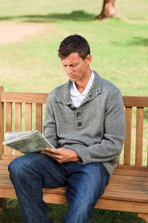 Handsome man making his crossword Stock Photo - 10197404
