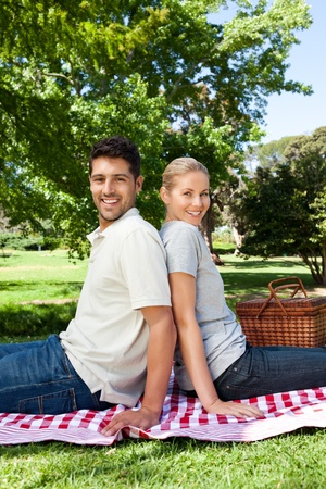 Lovers picnicking in the park photo