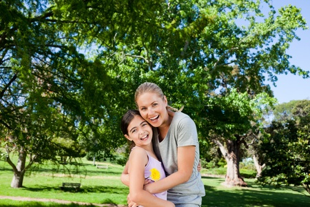 Cute daughter with her mother in the park photo