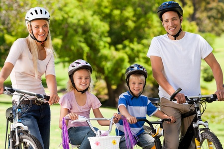 Family in the park with their bikes Stock Photo - 10185535