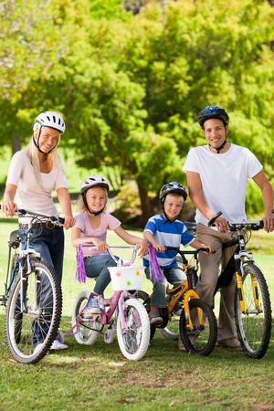 Family in the park with their bikes photo