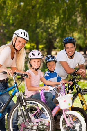 Family in the park with their bikes Stock Photo - 10190223
