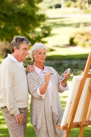 Senior couple painting in the park photo