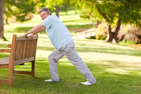 Retired man doing his stretches in the park Stock Photo - 10190362