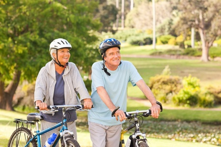Mature couple with their bikes Stock Photo - 10190388
