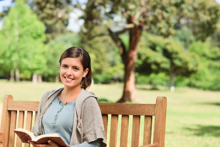 garden bench: Lovely woman reading