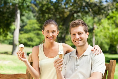 Couple eating an ice cream in the park Stock Photo - 10185434