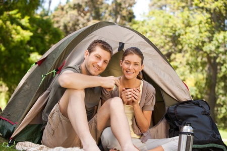 Couple camping in the park photo
