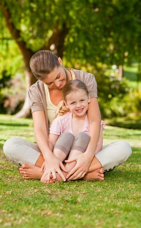 Daughter with her mother in the park photo
