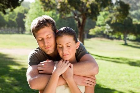 Man hugging his beautiful wife photo