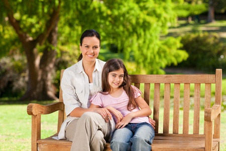 Mother and her daughter on the bench Stock Photo - 10195091