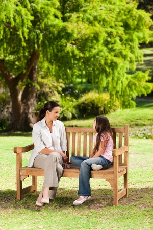 Mother and her daughter on the bench photo