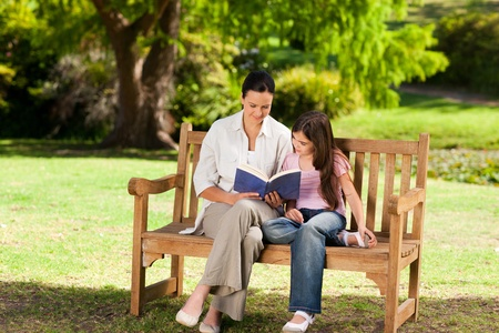 Mother and her daughter reading a book photo