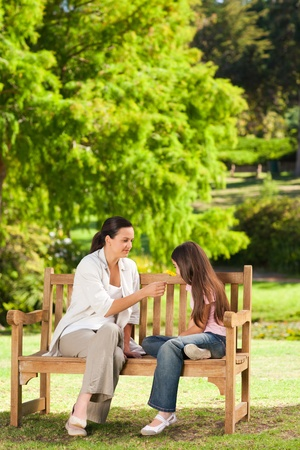 Cute girl with her mother in the park photo