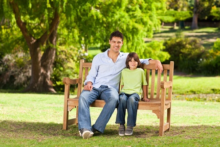 bench: Father with his son on the bench Stock Photo