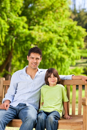 Father with his son on the bench Stock Photo - 10194586