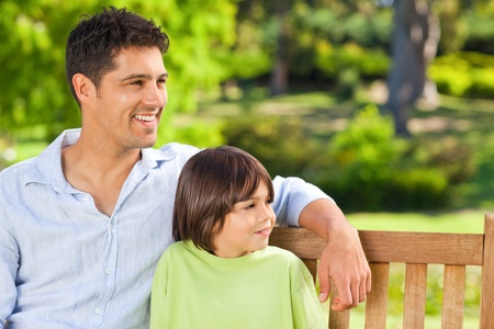 Son with his father on the bench Stock Photo - 10195083