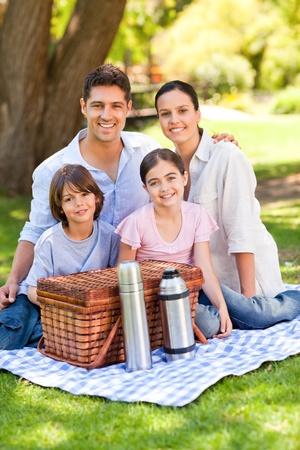 Happy family picnicking in the park photo