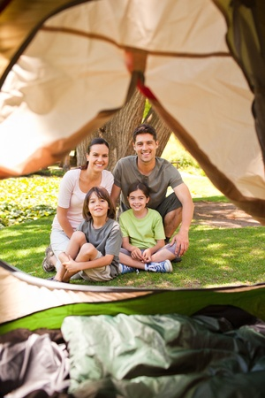 Joyful family camping in the park photo