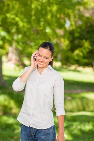 Young woman phoning in the park Stock Photo - 10190870