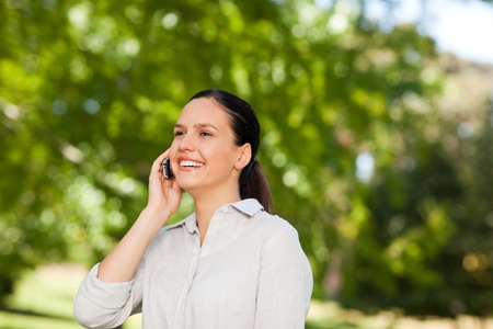 Young woman phoning in the park  photo