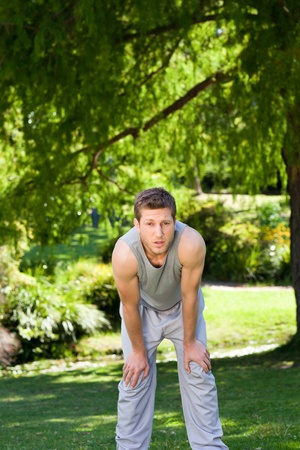 Sporty handsome man in the park photo
