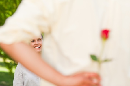 Man offering a rose to his girlfriend photo