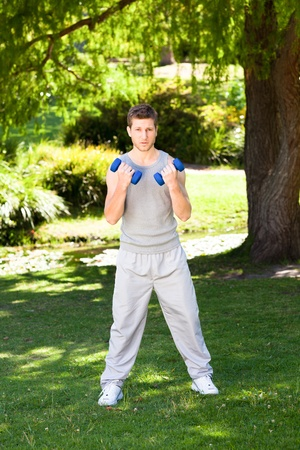 Man doing his exercises in the park photo