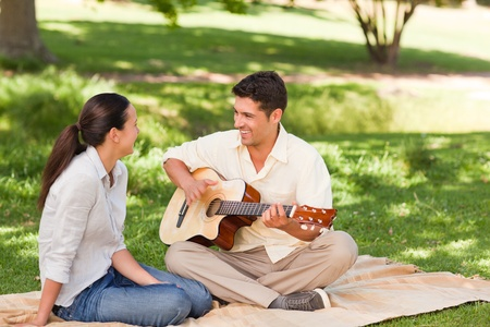 Romantic man playing guitar for his wife Stock Photo - 10192094