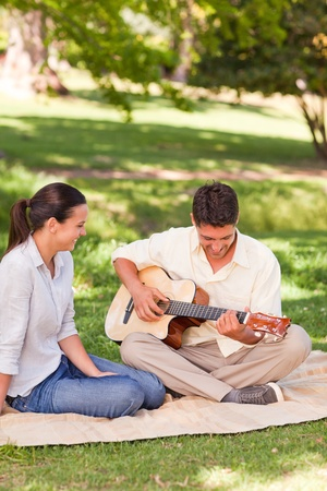Romantic man playing guitar for his wife Stock Photo - 10192173