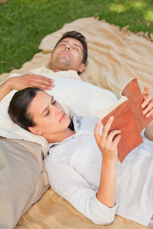 Couple reading in the park photo