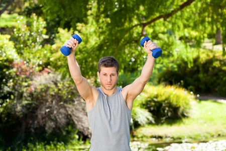 Man doing his exercises in the park Stock Photo - 10192101