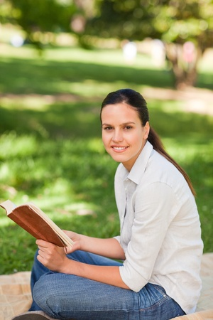 Woman reading in the park photo