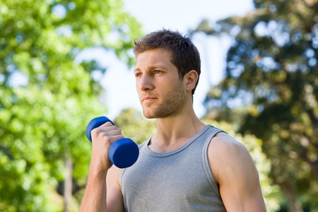 Man doing his exercises in the park Stock Photo - 10190873