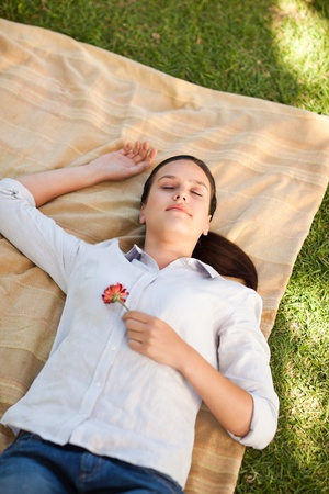 Woman sleeping with a rose photo