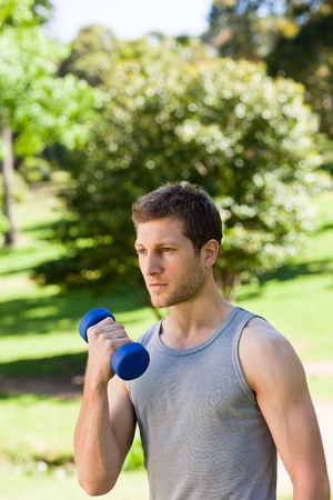 Young man doing his exercises in the park Stock Photo - 10194575