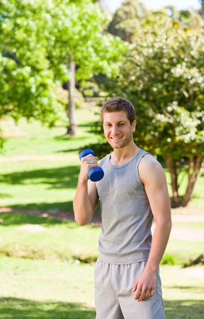 Young man doing his exercises in the park Stock Photo - 10190821