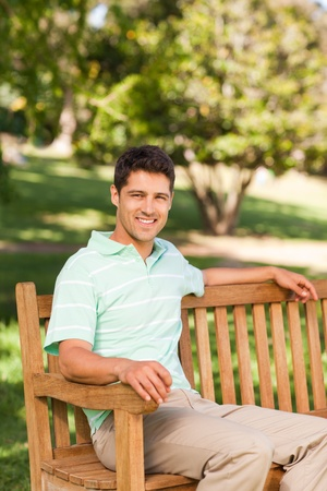 Handsome man on the bench photo
