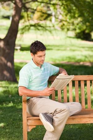 Man reading the newspaper Stock Photo - 10194372