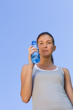 Young woman drinking water photo