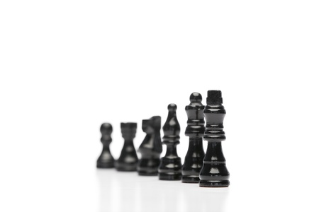 Black pieces of chess on a white background photo
